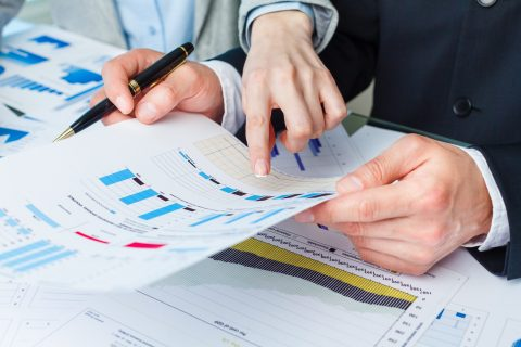 Woman explaining accounting principles to a businessman